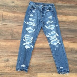 Ripped denim mom jeans with patches